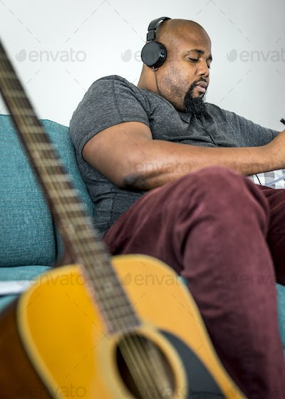 Man composing a new song