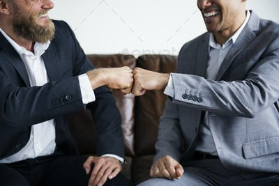 Two businessman sitting on a couch