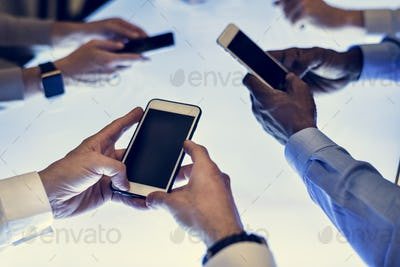 Group of hands holding using smartphone