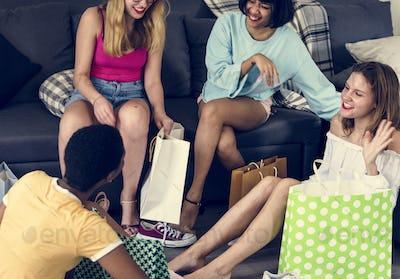 Women showing friends shopping shoes