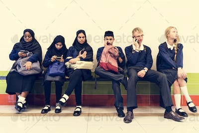 Group of diverse students using mobile phones