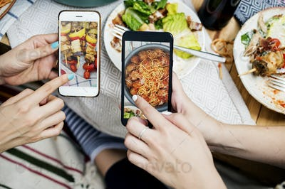 People sharing food photos on mobile phone