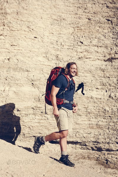 Hipster man traveling with backpack