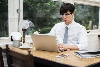 Businessman working on laptop in office