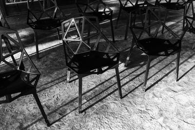 Group of black metal chairs