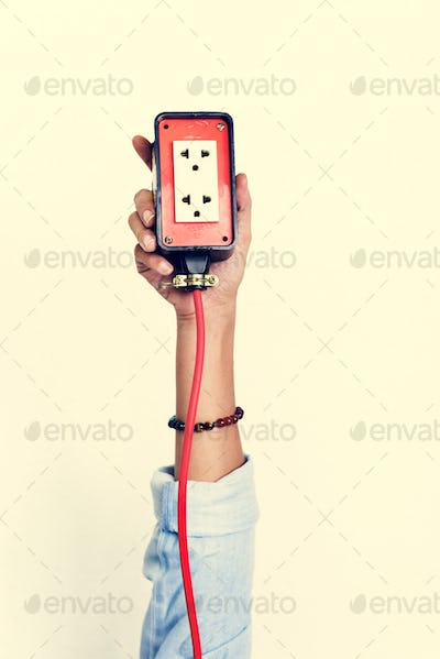 Hand holding electric outlet isolated on background