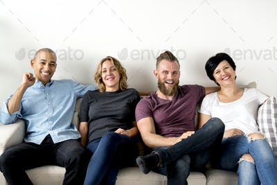 Diverse friends sitting together