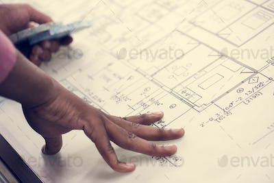 Close up of hands working on paperwork