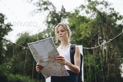 Woman following a map in nature
