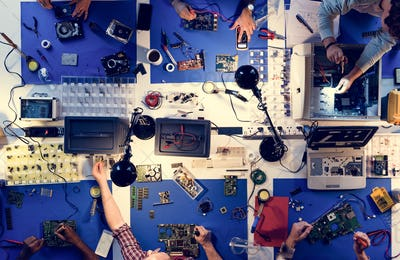 Aerial view of electronics technicians team working on computer parts