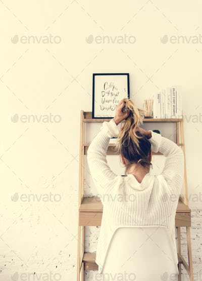 Rear view of woman tie her hair up