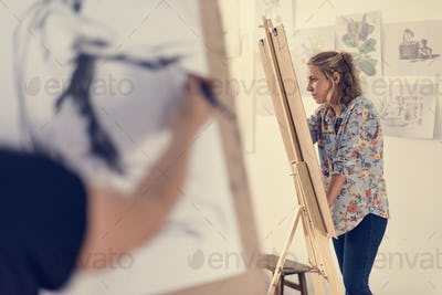 Woman working on painting