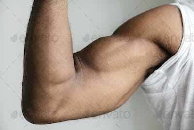 Closeup of a black person's muscular arm