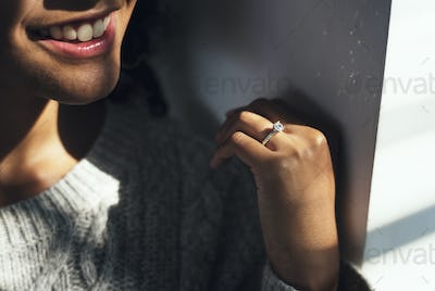 Cheerful woman with engagement ring
