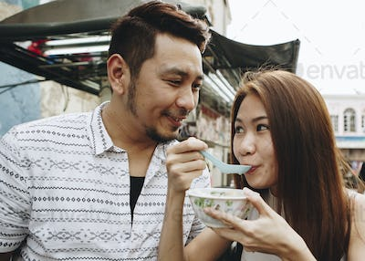 Woman having asian dessert outdoors