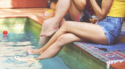 Girls relaxing by the swimming pool