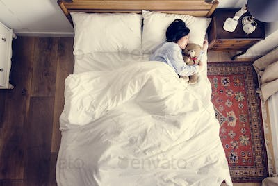 Asian woman sleeping with a doll