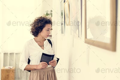 Woman looking at picture frames in an exhibition