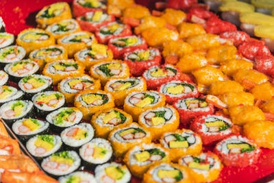 Colorful assortment of Sushi rolls