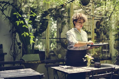 Woman working in a gardening shop