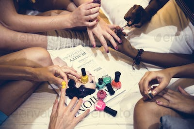 A group of diverse women painting their nails