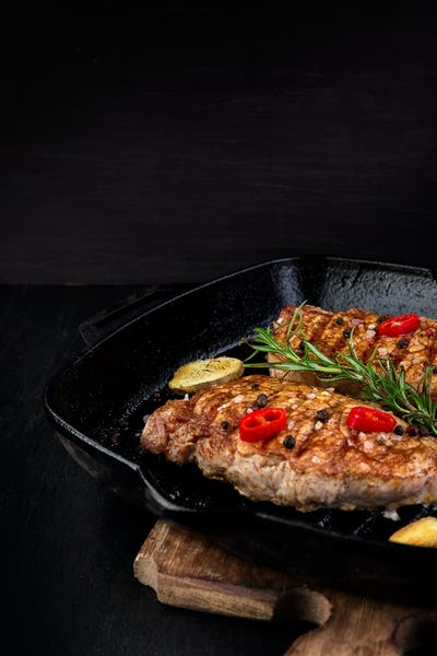 Grilled pork steak in grill pan