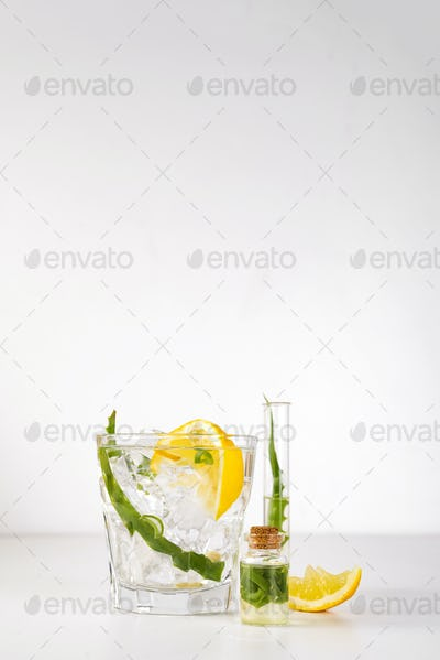 fresh aloe vera leaves and aloe vera juice in glass on white background