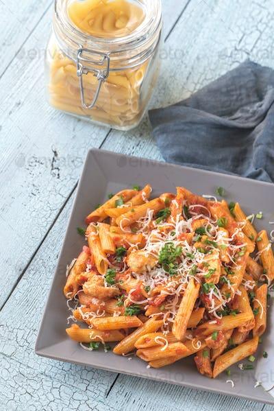 Portion of cheesy chicken pasta