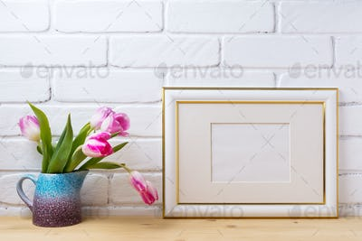 Gold decorated landscape frame mockup with magenta tulips