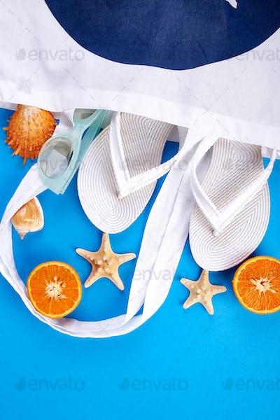 Summer beach bag with flip flops,