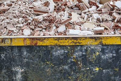 Removal of debris. Construction waste. Building demolition. Devastation background