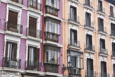 Antique building classic colored facades in Madrid city center. Spain