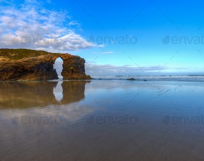 The iconic stone arch of the beach of As Catedrais