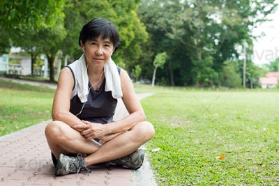 Senior woman resting after jogging