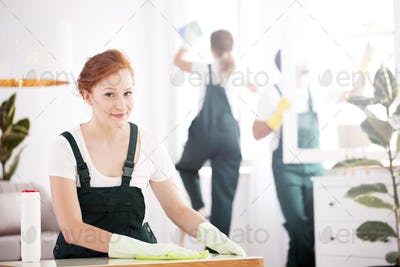 Cleaning lady dusting table