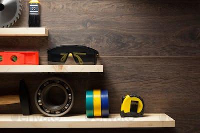 construction tools at wooden shelf
