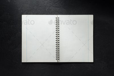 notebook on black background