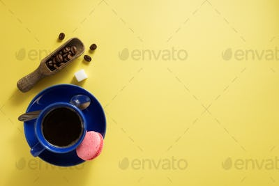 coffee cup and beans at yellow  background