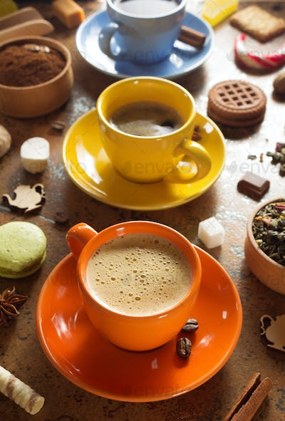 cup of coffee, tea and cacao at table