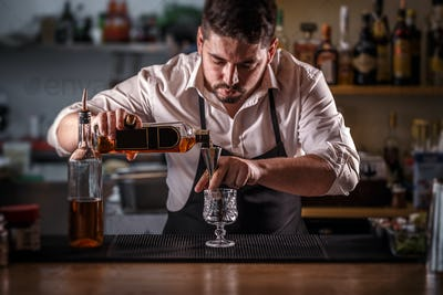 Bartender preparing alcohol cocktail drink