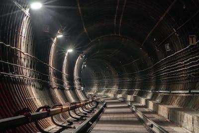Turn in the underground metro tunnel