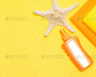 Suntan lotion, starfish and towels with free space for text