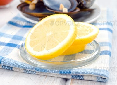 wheels cut lemon in glass dish
