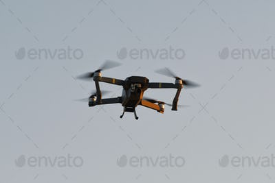 Drone quad copters with high resolution digital camera flying aerial