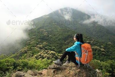 Hiker enjoy the view on spring forest mountain top