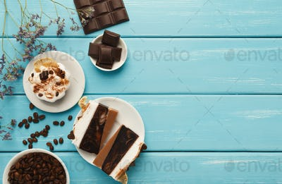 Various desserts: cakes and chocolate bars on turquoise rustic t