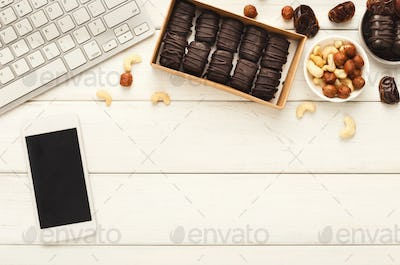 Working desktop with healthy sweets and nuts