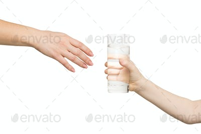 Kid giving glass of water to mother, isolated
