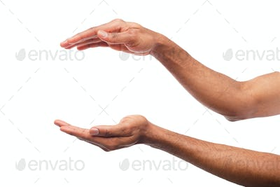 Black male hands keeping something, cutout