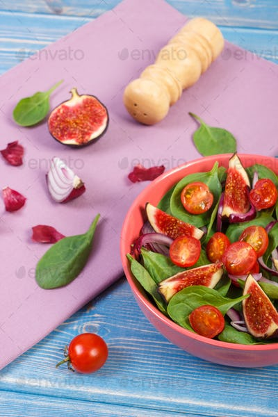 Fresh prepared fruit and vegetable salad and ingredients for preparing meal